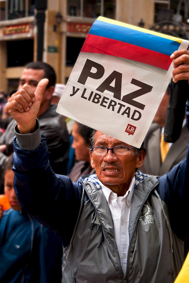 An anti-FARC protestor holds a sign demanding peace and freedom during demonstrations in Bogota. Photo: Jkraft5 | Dreamstime.com