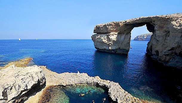 The Azure Window, a natural limestone arch which has served as a setting for several films and television series
